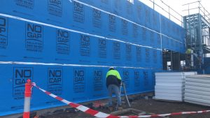 Installing wall wrap at a No Gap Insulation job site